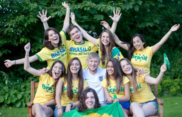 Ludlow Advertiser: Mike Slade surrounded by supporters of Brazil at St Michael's International College near Tenbury.