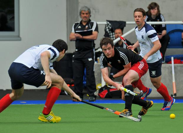 Ben Carless in action for Wales in a warm-up match against Scotland at the National Hockey Centre in Glasgow Green.
