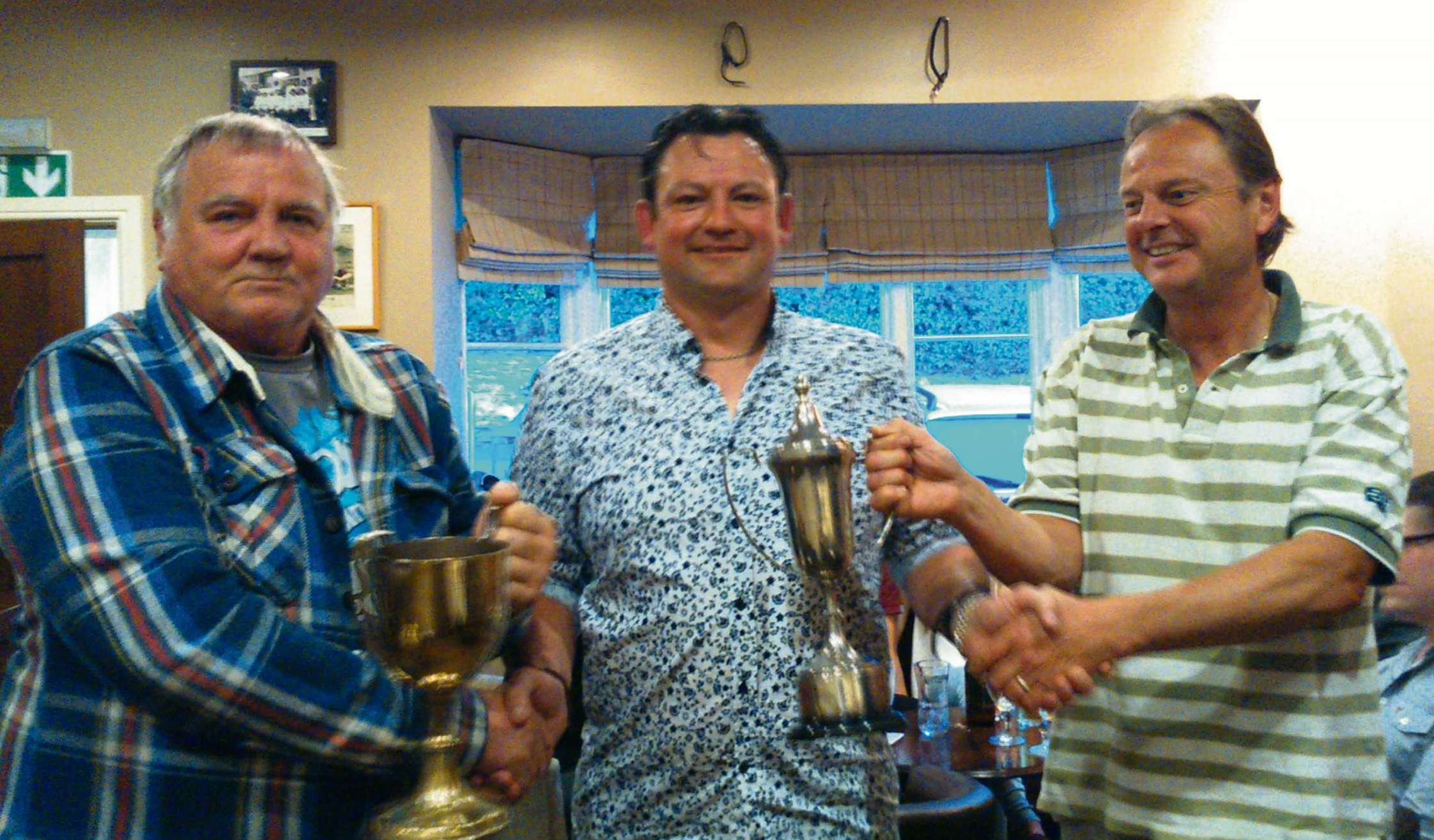 Chris Shurmer (centrre) with chairman Bob Morris (left) and secretary Alan Pearson.
