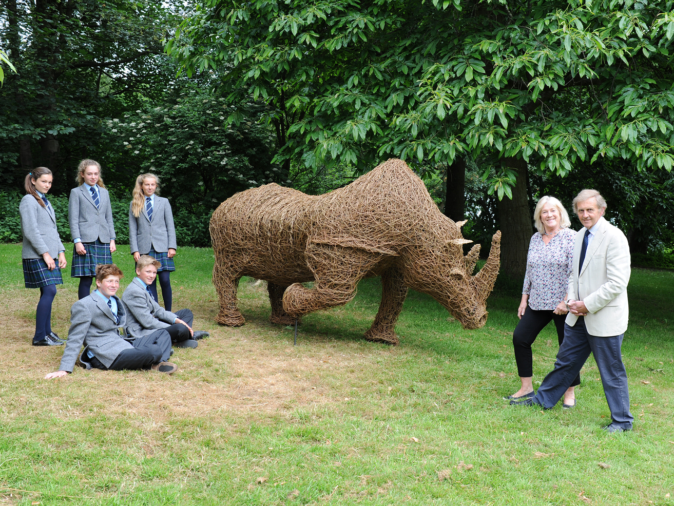 Retiring Abberley Hall School headmaster John Walker and wife Janie with some of the final year pupils who helped to create a wicker Rhino statue as part of this leaving present.