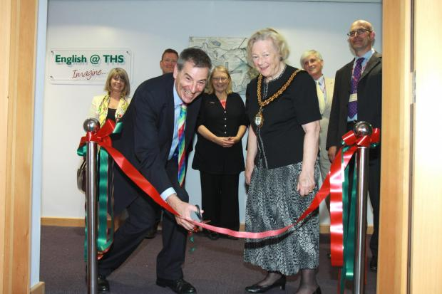 Opening of new building at Tenbury High School by Prof David Green, Vice-Chancellor and CEO of the University of Worcester. Prof David Green cuts the ribbon to officially open the new building with the help of Pam Davey, Chariman of Worcestershire County