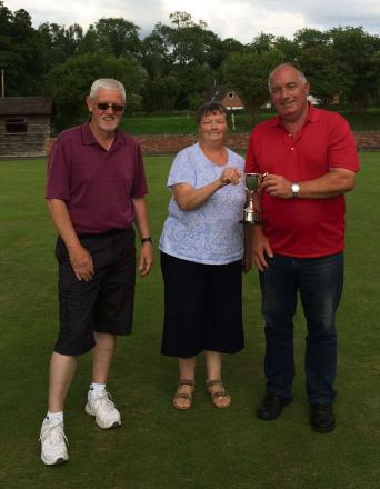 Roy Crowther (far right) with runner-up Mike Weston (left) and league chairman Lillian Payne.