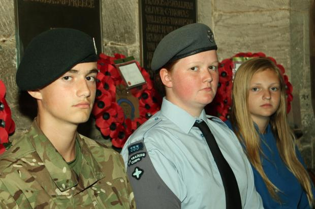 Army cadet Marcus Griffiths, air cadet Joanne Povall, and Chloe Powell-Bevan, of St. Laurence's Church Choir, will be reading out the names of the war dead. Photo: MARK BOWEN.