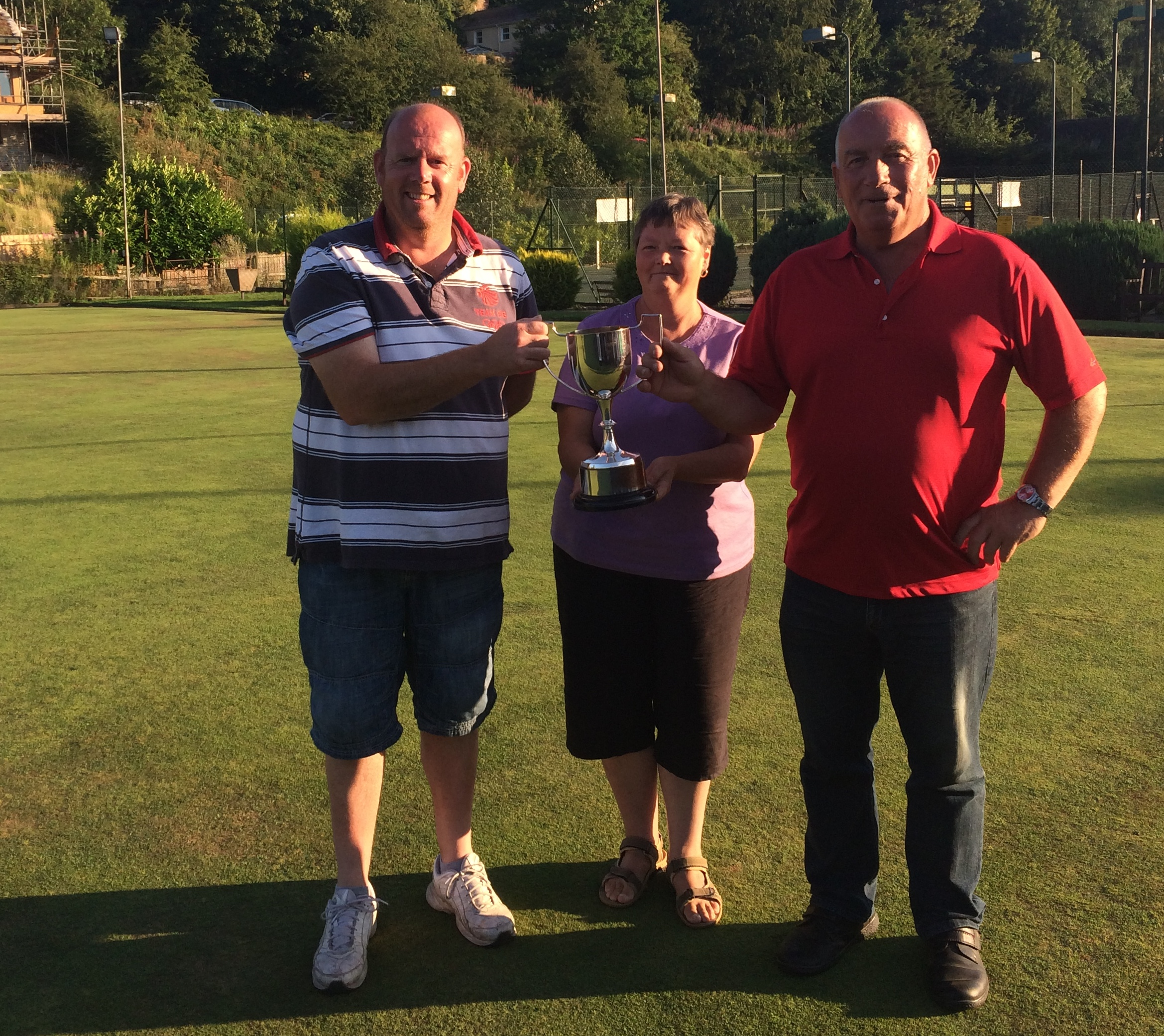 Duncan Pressley (left) and Roy Crowther (right) receiving the trophy from league chairman Lillian Payne.