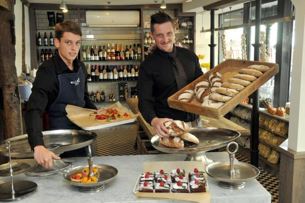 De Greys deli supervisor Owen Holder and general manager James Warr prepare the cakes and bread ready for customers. Picture: Andy Compton.