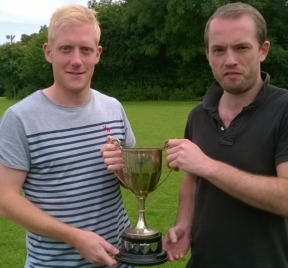 Woofferton's Bryn Martin (left) receives the Stephen Apperley Cup from Ben Apperley.