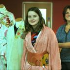 Ludlow Advertiser: Eva Basnett tries on a Kimono helped by her mum Tracey. 1442_51005 (11394589)