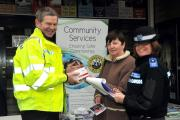 PC Paul Lambon talks about a shed alarm to Carol Stevens watched by PCSO Teresa Howells. 1507_54001