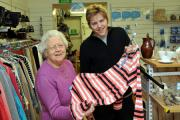 Volunteers Sheila Palmer and Alex Yates with a spring fashion garment