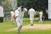Players from Ludlow 2nd run from cover as rain stops play in their match against Wellington 4th. Photos: ANDREW COMPTON