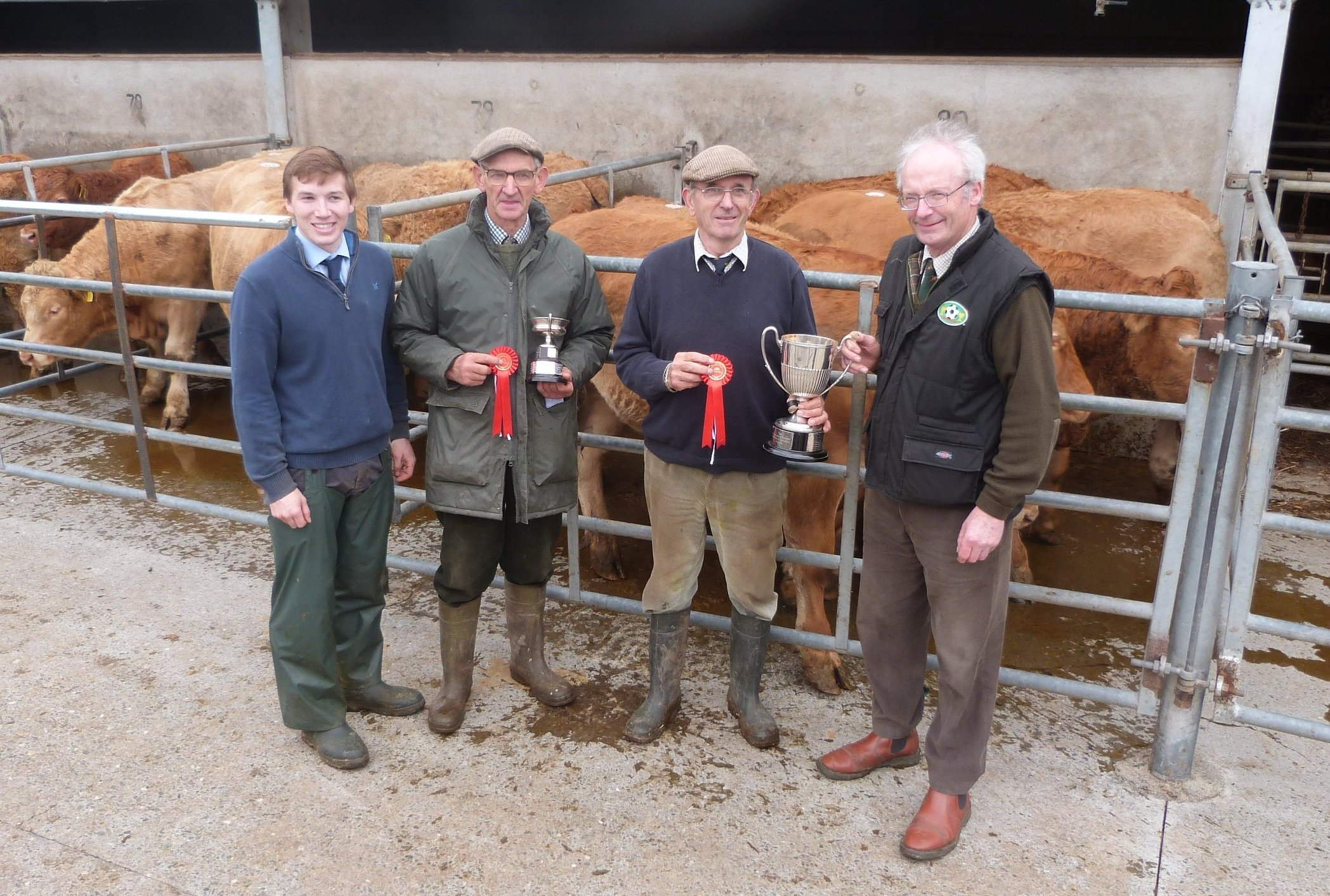 Richard Watkins (McCartneys), Messrs JR and T Franks, Bachefield Farm, Kimbolton (winners of both the Best Pen of Steers and Best Pen of Heifers) and Charles Forrester (judge)