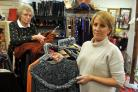 Sorting stock out in the shop are volunteer Carol Atack and assistant manager Helen Lewis