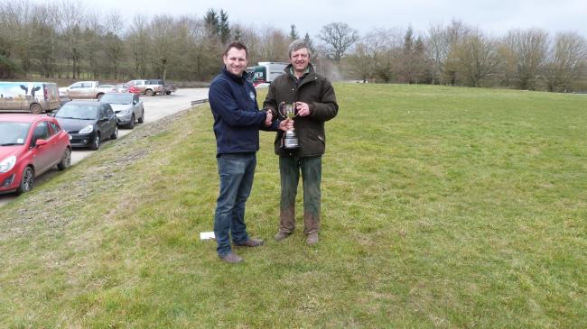 From the Ludlow Easter Show and Sale, Robert Medcalf, wholesale butcher from Yorkshire who judged the Finished Cattle presenting the Ludlow Chamber of Commerce Trophy for the Champion Beast in the show to Jim Phillips of Phillips, Bockleton Farm Ltd who s