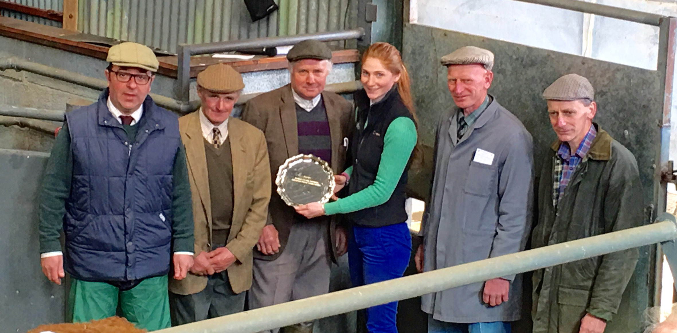 Kimberley Dudley of Allflex presents the salver to Phil and Mike Wood watched by Halls' director James Evans (left) and judges Grahame and Clive Stubbs.