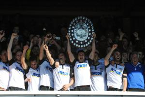 Joel Edwards lifts the Southern League South & West shield. Photos: James Maggs