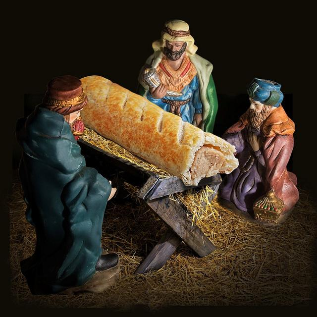 Greggs' publicity for its new Advent Calendar, featuring a sausage roll in a manger