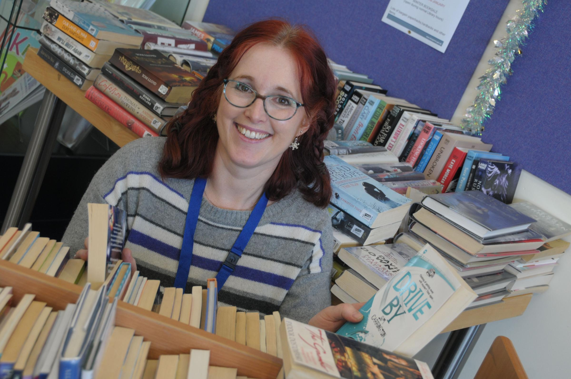 All types of books are being sold at a sale held in Ludlow Library until the end of January. Fiction, none fiction, childrens' and large print books are just some of the selection for sale. Sorting through the stock is library assistant Angie Watkins.