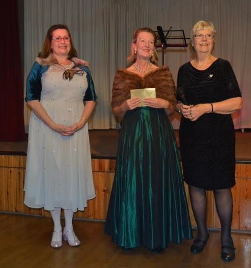 Knowbury WI president Helena Brooke was presented with a certicate by representatives from Shropshire WI