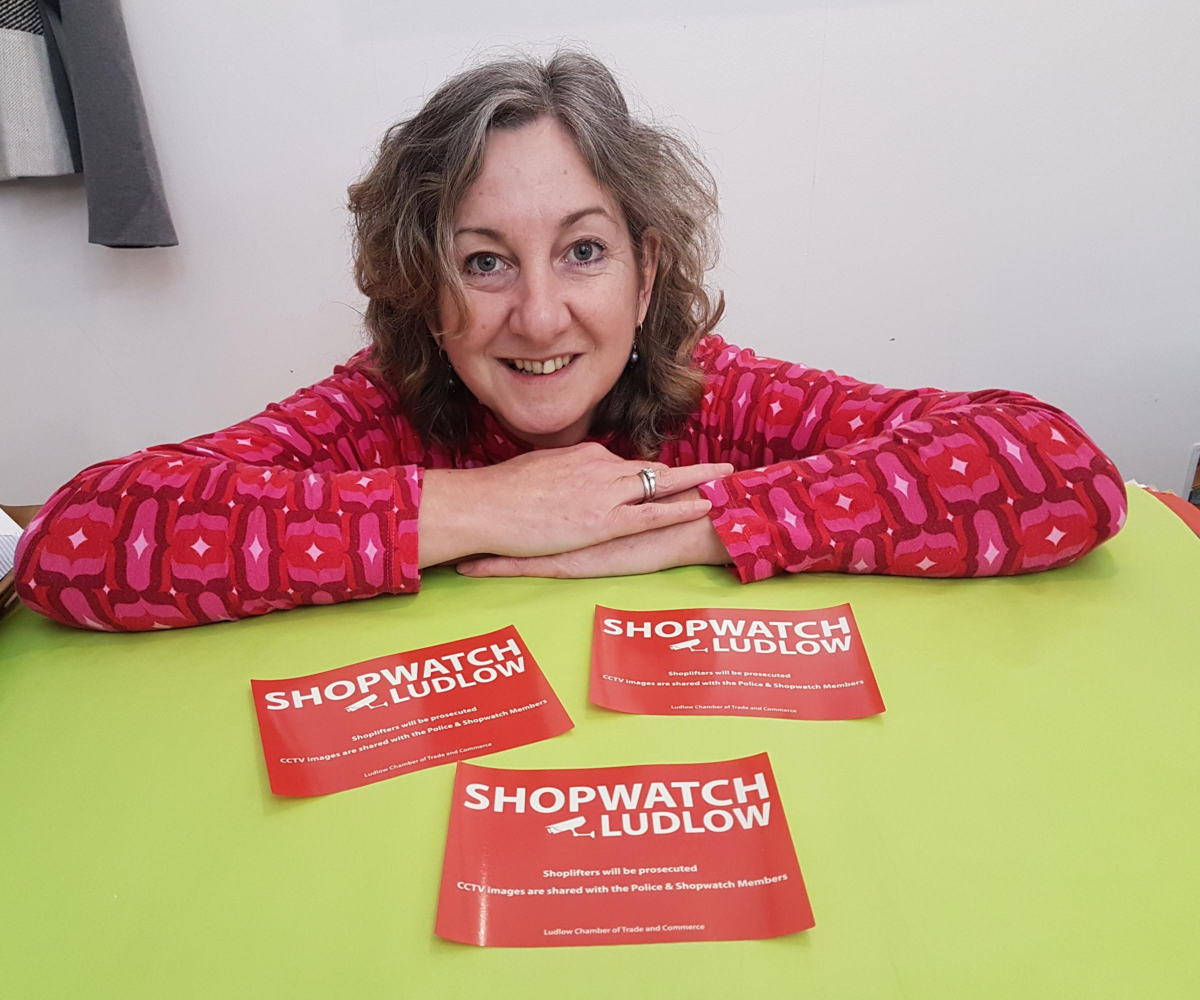Vicki Ortwell from Eclectica with Shopwatch window stickers