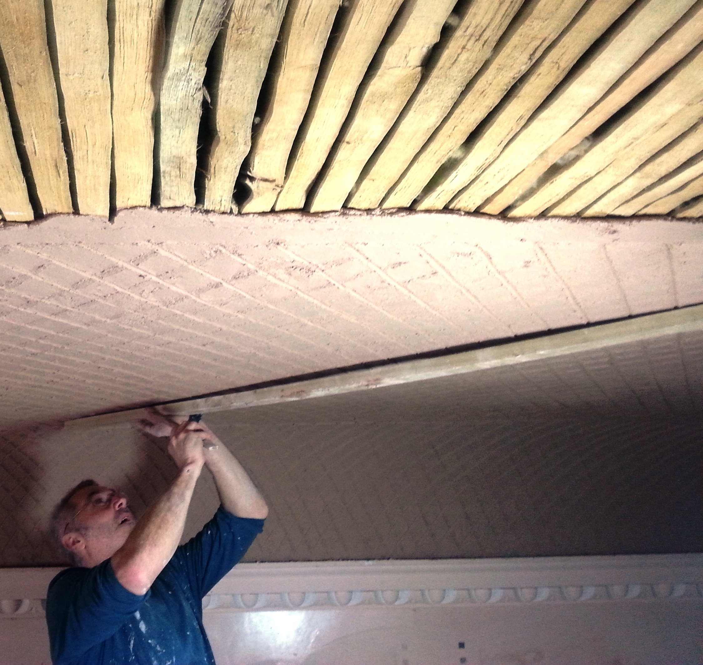 Stuart Preece applying lime plaster at the Buttercross