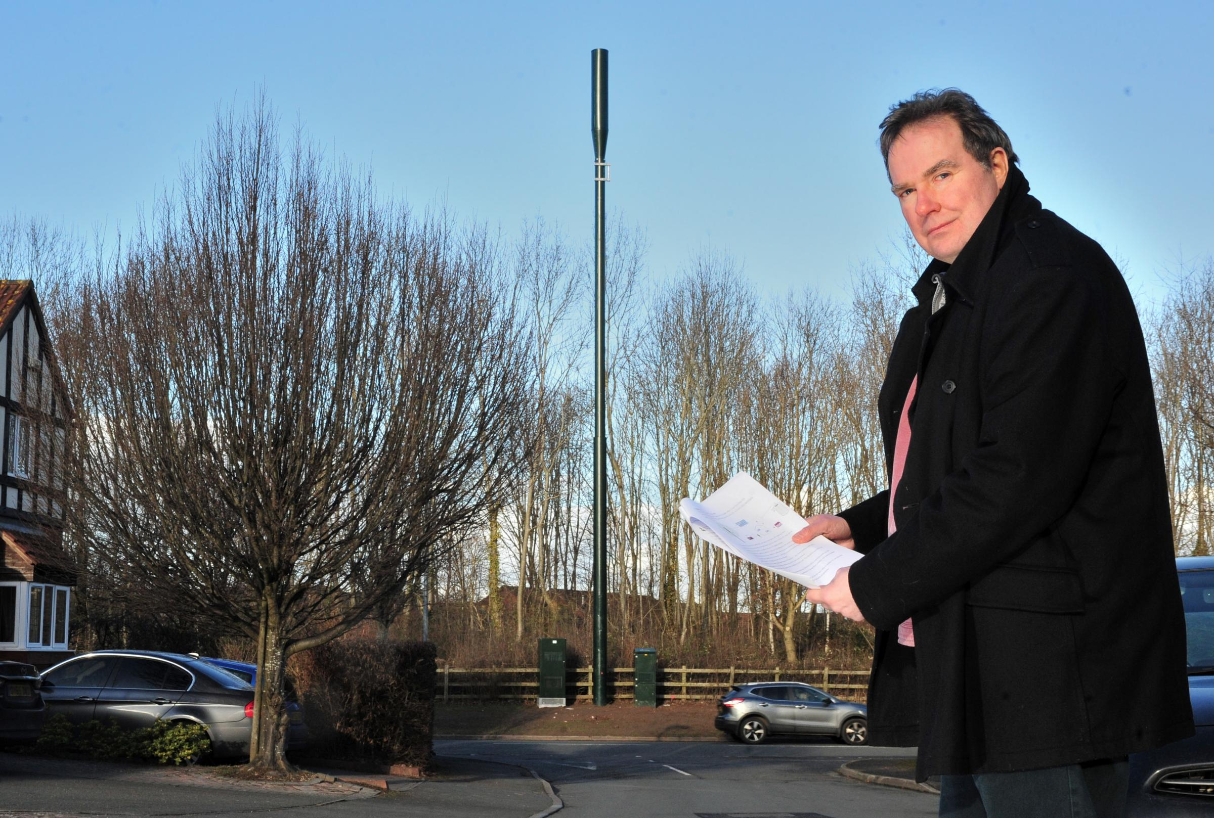Councillor Stephen Hodgson, with the new phone mast on Plantation Drive, Warndon Villages. Picture: Jonathan Barry