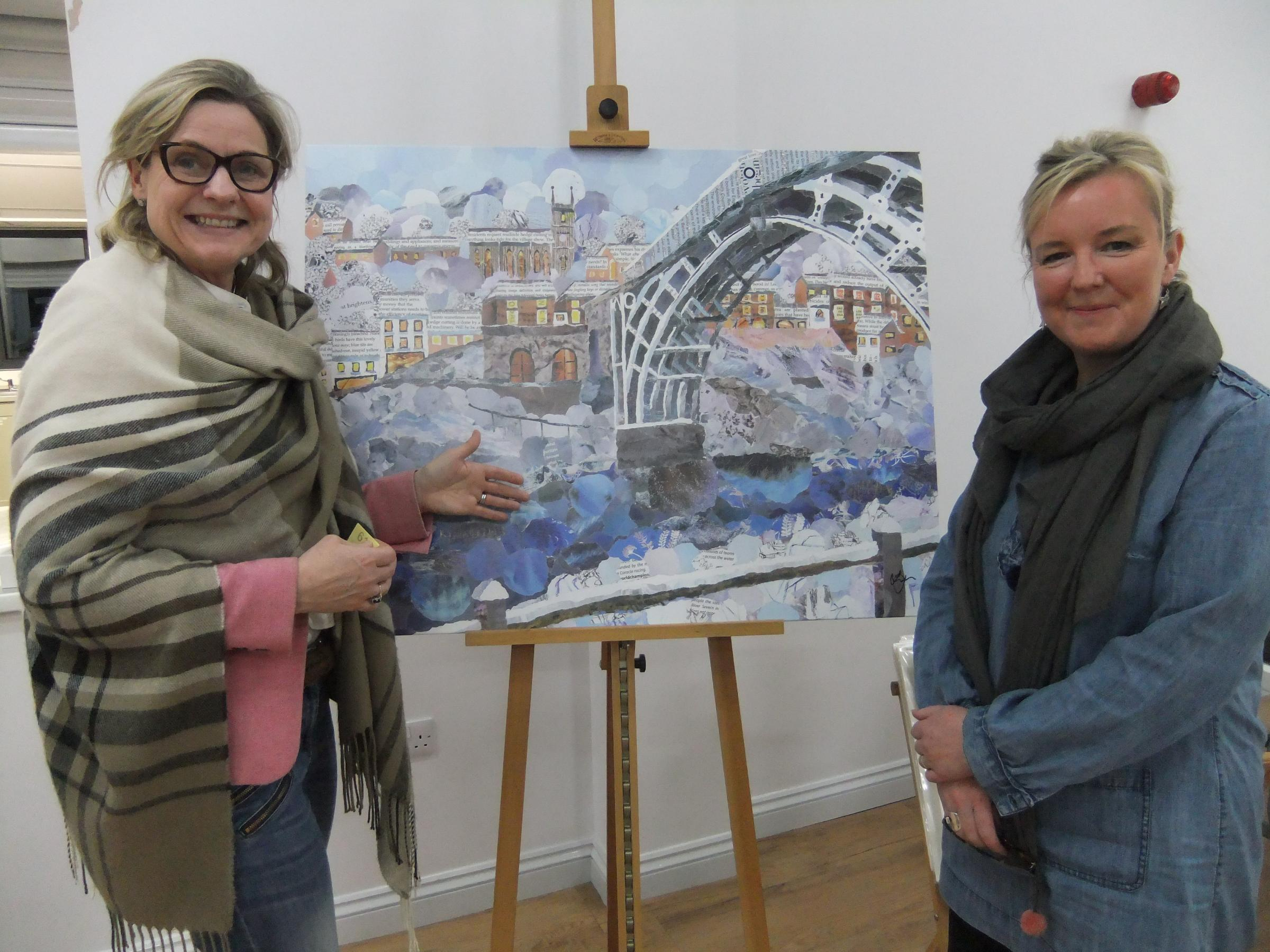 Photo: Lyn Evans (right) talking to Gilly Bachelor about her Ironbridge picture