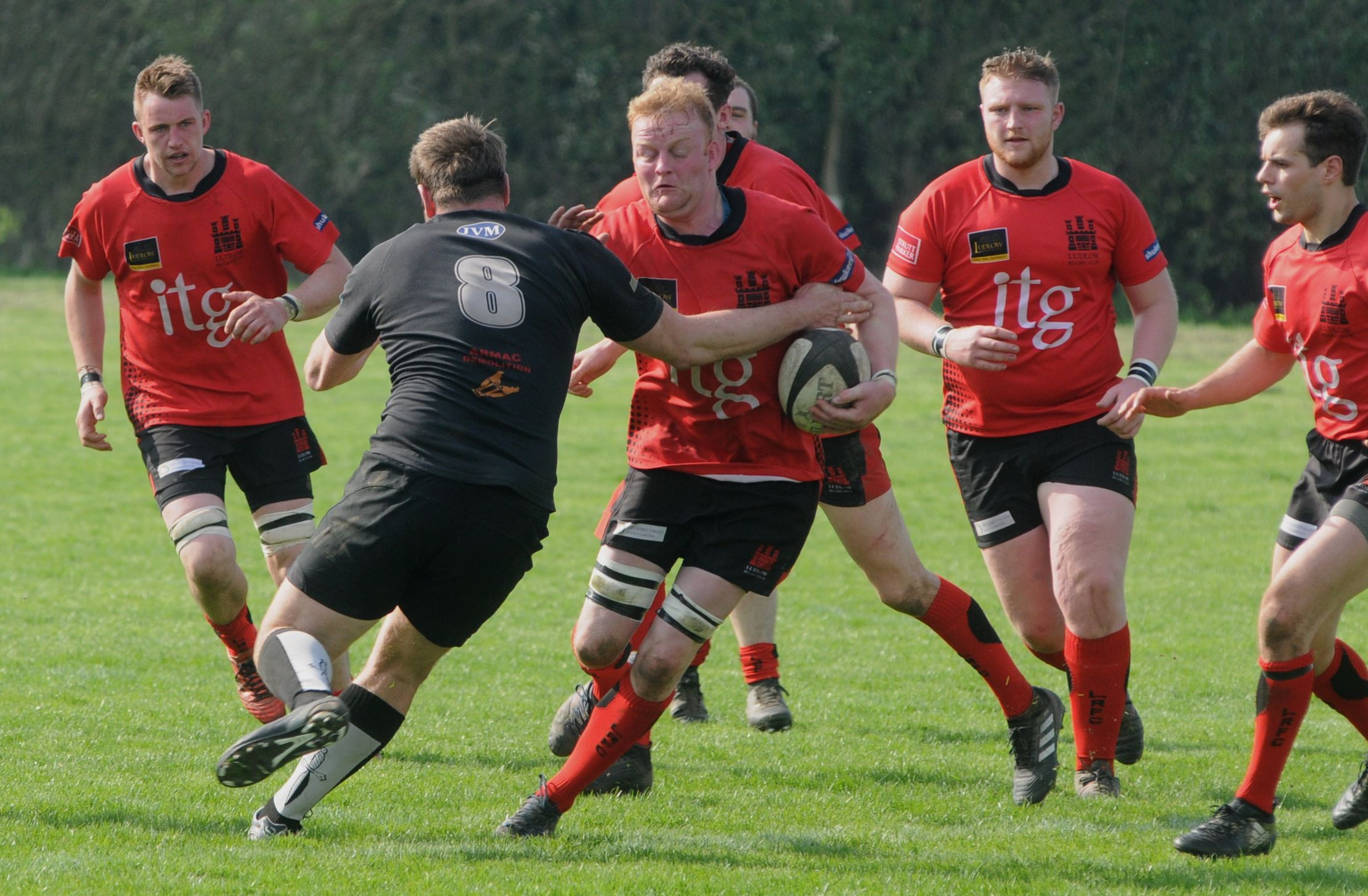 Ludlow's Matt Davies is tackled by a Spartans player..