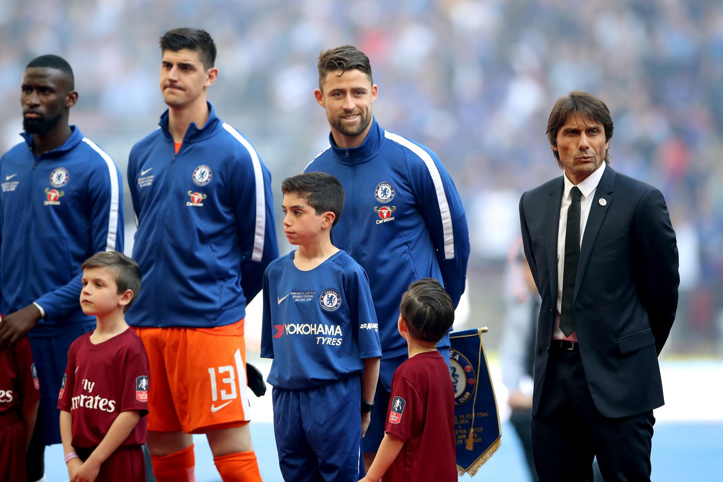 Gary Cahill, second right, hopes for a swift answer on the future of Antonio Conte, right, as head coach (Nick Potts/PA Images)
