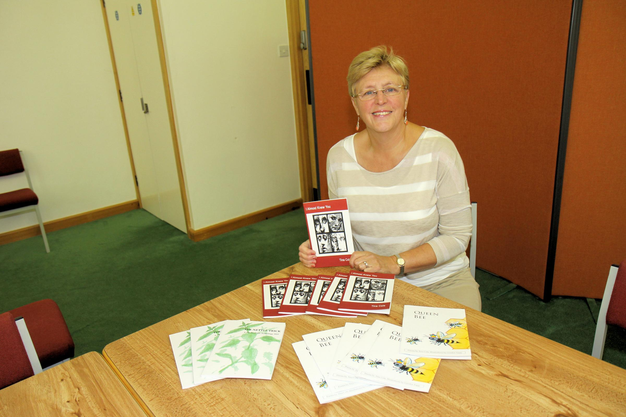 Poet Tina Cole with her book 'I almost knew you.'.