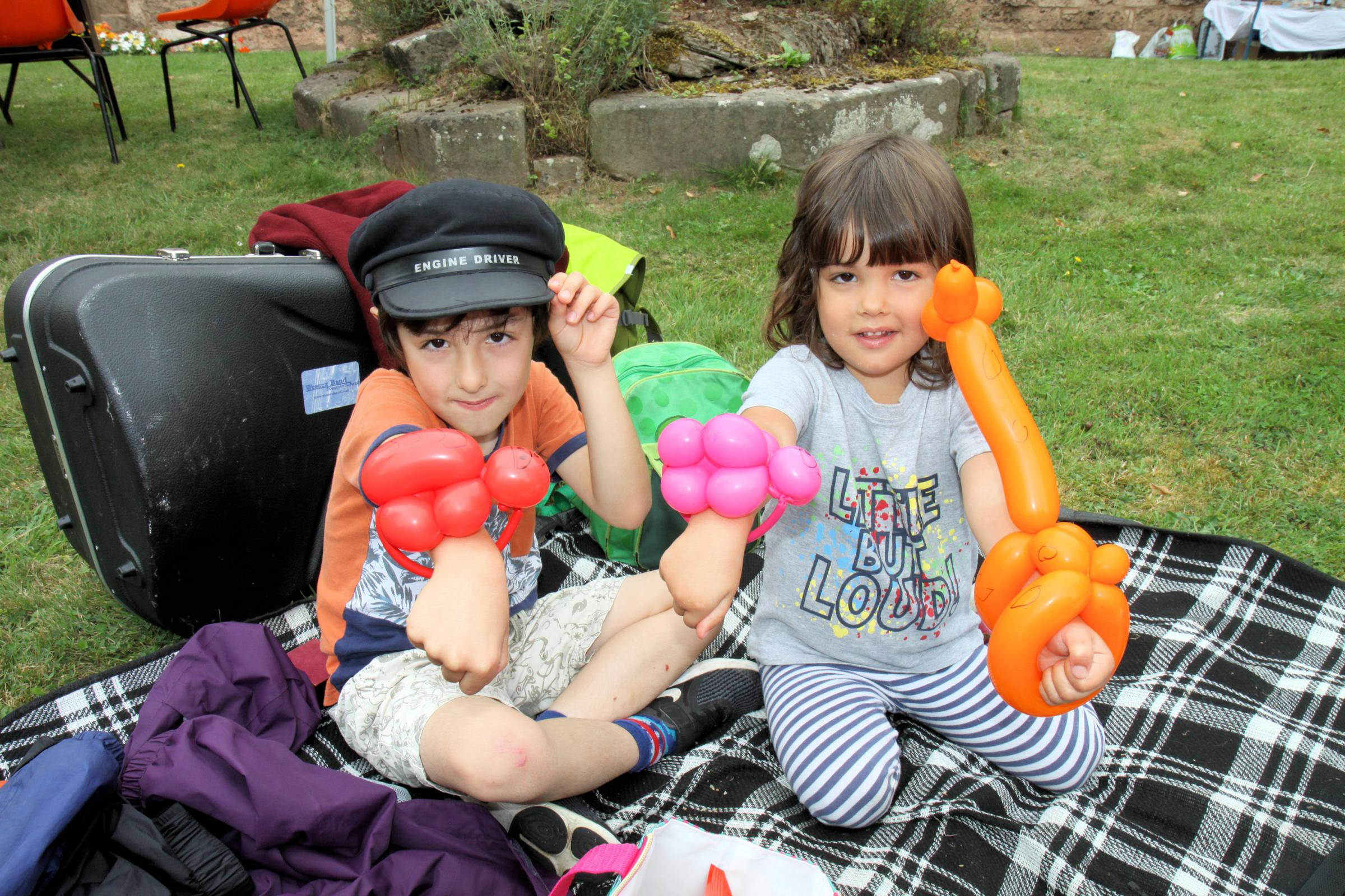 William and Florence Holmes have a picnic and play with the balloon figures made for them at the fete.