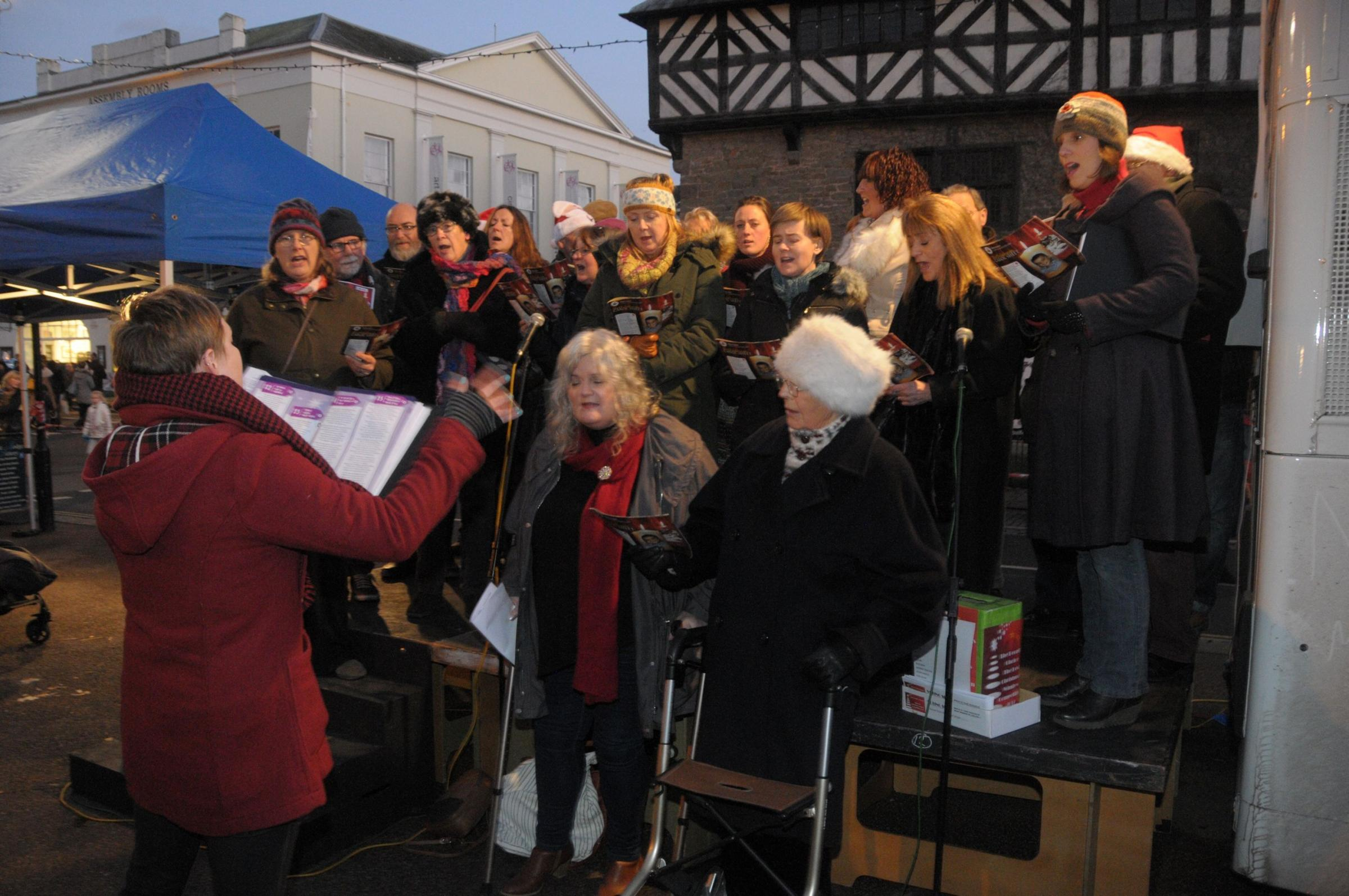 Singers entertain visitors prior the the switch on of Ludlow Christmas Lights..