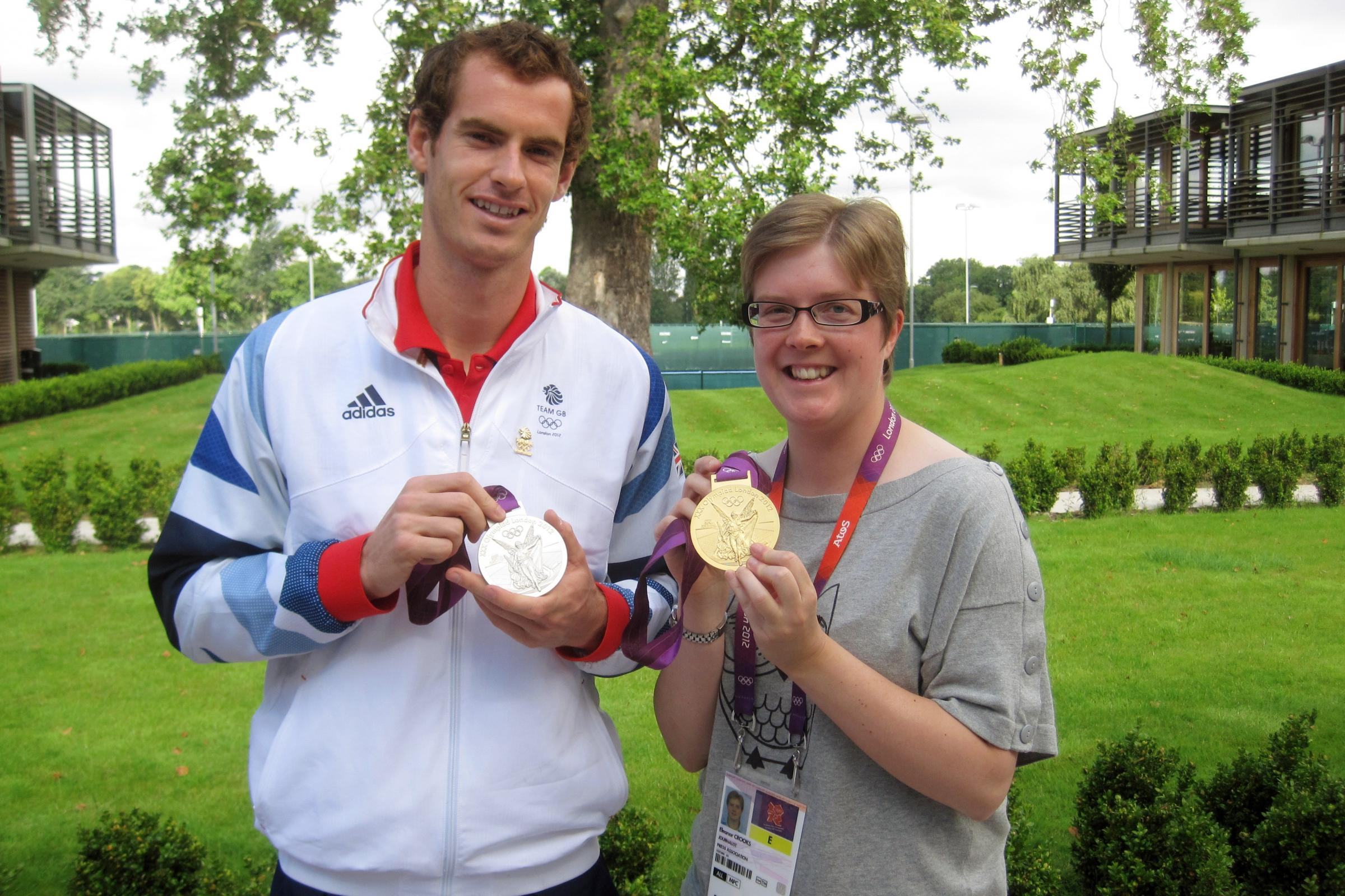 Andy Murray poses with his gold and silver medals from the London 2012 Olympics alongside Press Association journalist Eleanor Crooks