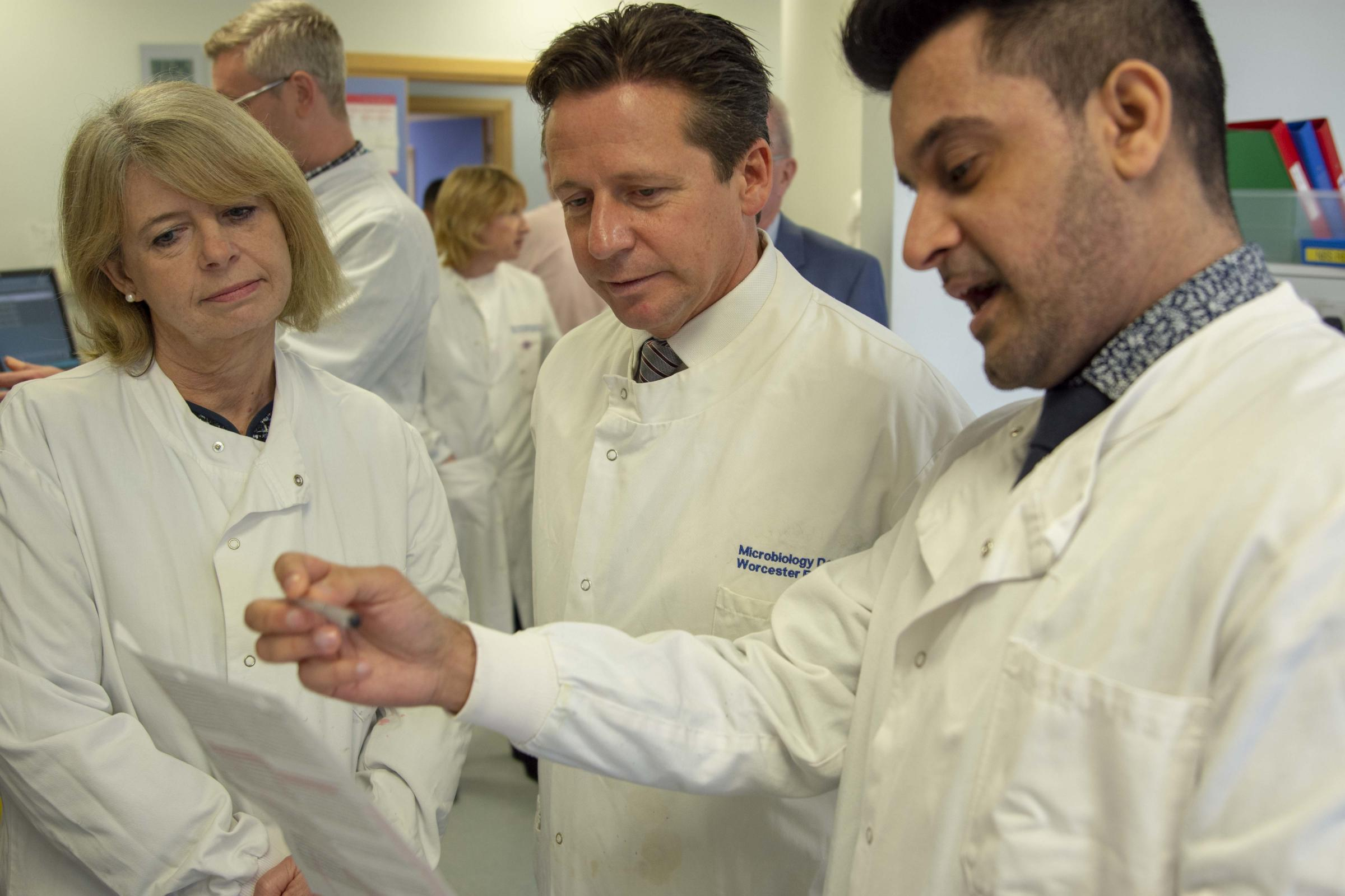 Pictured (l-r) Harriett Baldwin MP, and Nigel Huddleston MP take a tour of Worcestershire Royal Hospital's Path Lab with Camran Khan, Blood Bank Manager.
