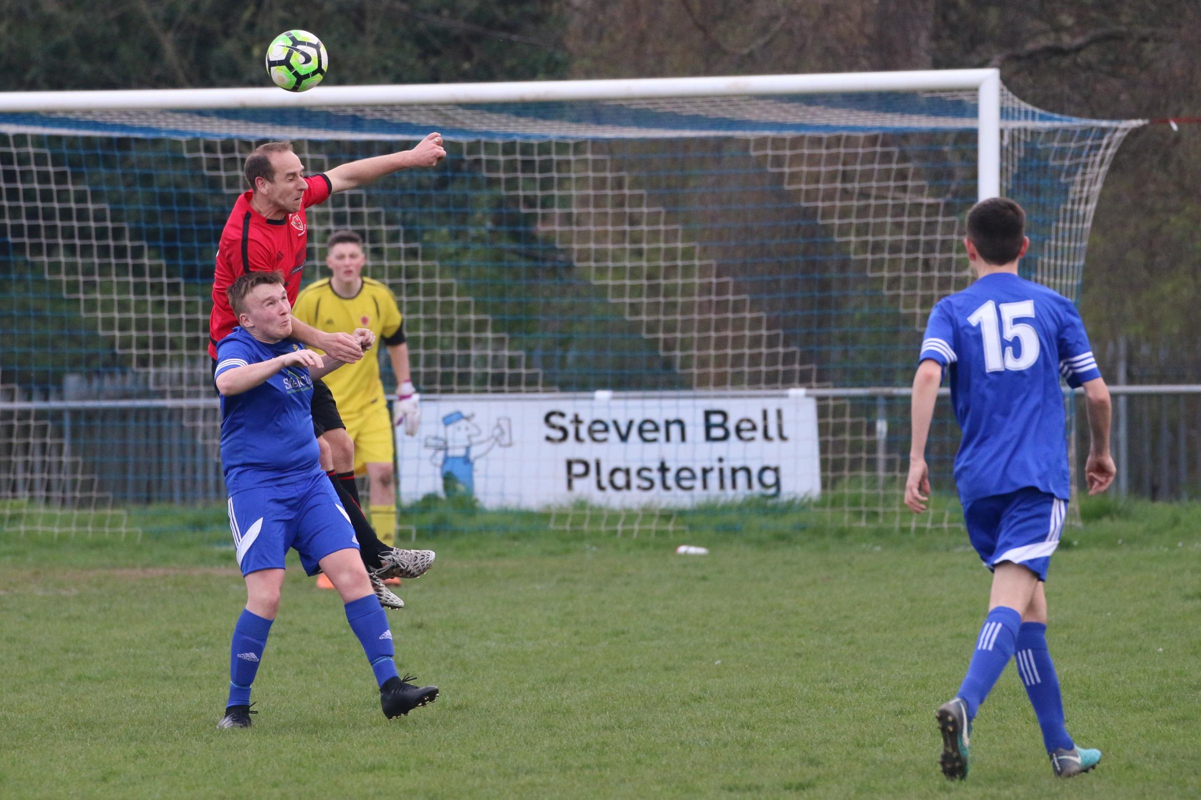 Phil Davies rises highest to win a header against Lads Club Reserves. Picture: Graham Gould