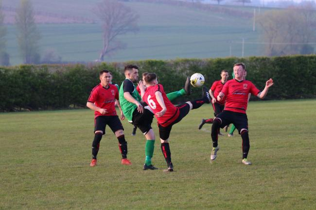 Kieran Dovey battles for the ball as his side lifted the league title. Picture:Graham Gould