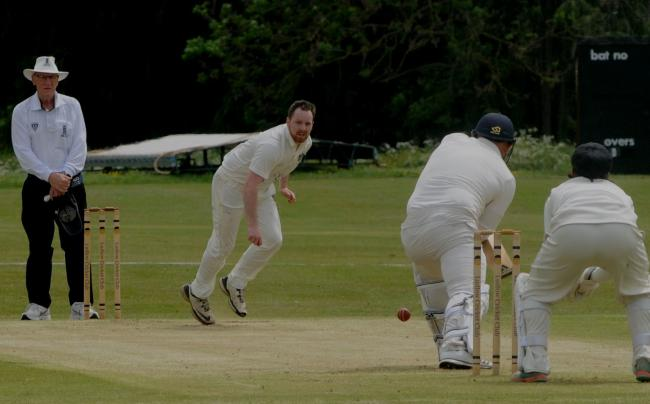 Ludlow bowler Louis Watkins delivers to St Georges batsman Matthew Chesters