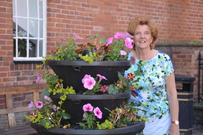Vivienne Parry with flowers in the town centre