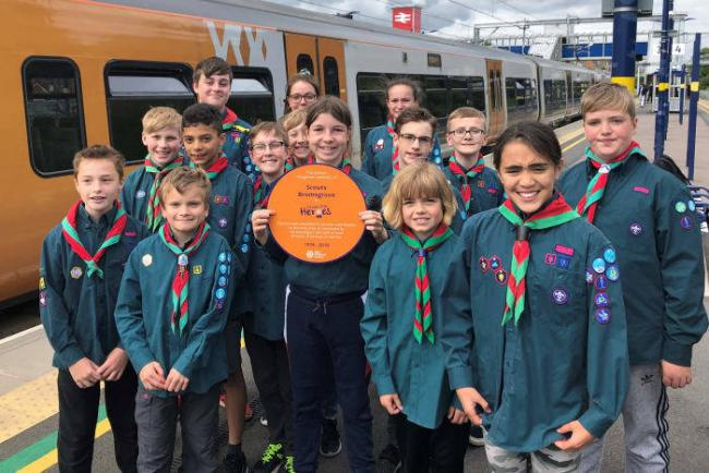 Finstall Scout Troop with their Cross City Heroes plaque. This will be displayed at Barnt Green station this summer. Credit - Peter Dodman